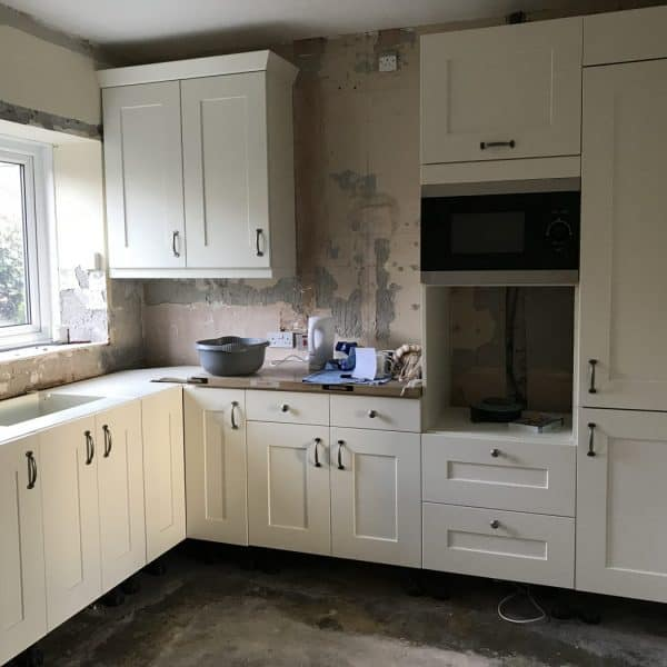 Getting the new kitchen fitted at Stanegate Cottage in Northumberland